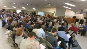 Residents pack school to testify against pipeline compressor station.