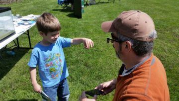 Boy shows off crayfish from Maumee River.