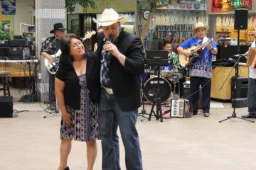 Gloria Pizana dancers with band leader Jacob Estrada.