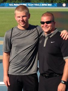AJ Digby with coach DJ Michel.