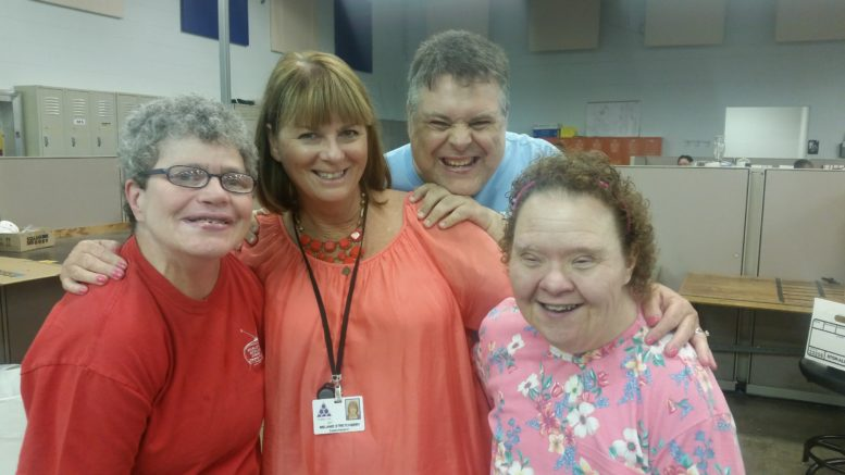 Melanie Stretchbery is surrounded by Kathy Digby, Ray Goodman and Darlene Bowers at Wood Lane Industries.