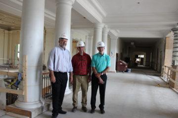 John Fischer, Brian Swope and Steve Krakoff inside University Hall.
