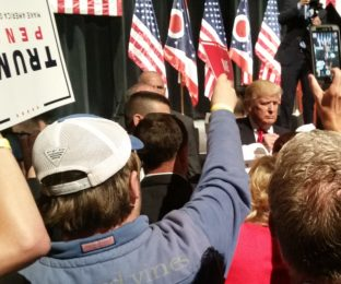 Supporters greet Donald Trump after rally in Toledo.