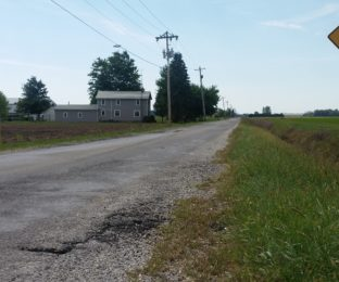 """""""Rough road"""" sign alerts motorists on Bloomdale Road."""