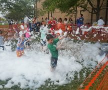 Kids are covered with foam at STEM in the Park.