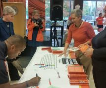 People sign Not In Our Town pledge during Thursday's gathering.