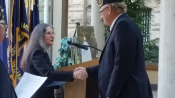 Veteran Mary Hanna thanks member of honors detail