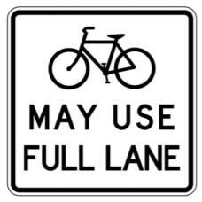 Some communities use this sign to explain cyclists' rights.